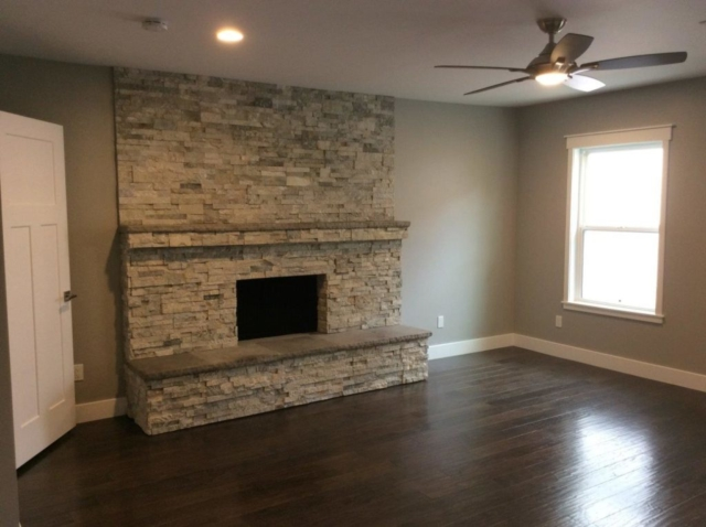 Residential painted room with fan and fireplace included