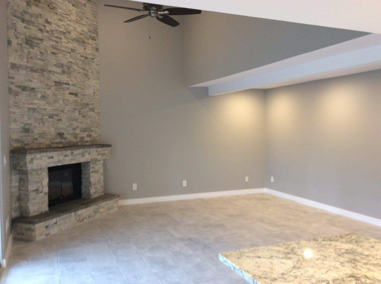 Residential house with fireplace and new paint job
