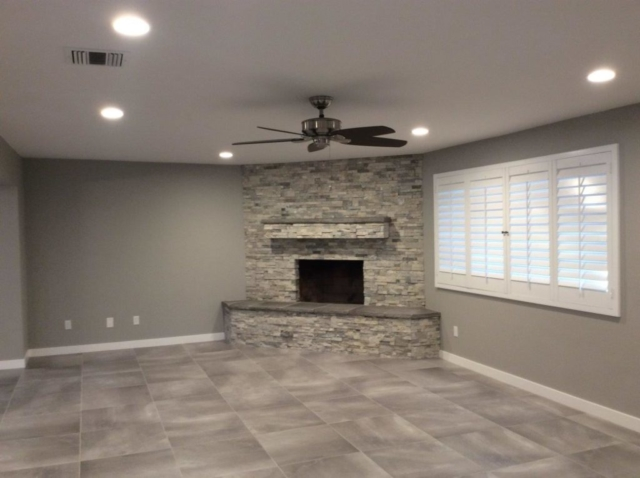 Newly painted room with fireplace