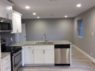 House with painted brick and newly painted walls  in kitchen area